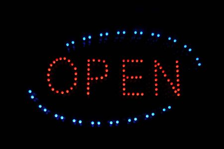 Open Neon Sign in Blue Red and Black photo