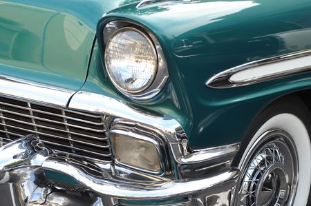 timeless: Vintage Aqua Blue Car showing Headlight and Tire