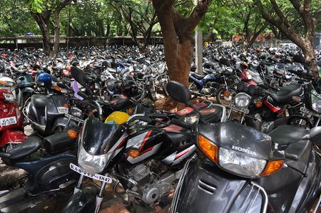 Bangalore, India - July 11: Motorcycles parked for a Horse Racing event July 11, 2010 in Bangalore.  India with an estimated 37 million motorcyclesmoped is home to the largest number of motorised two wheelers in the world