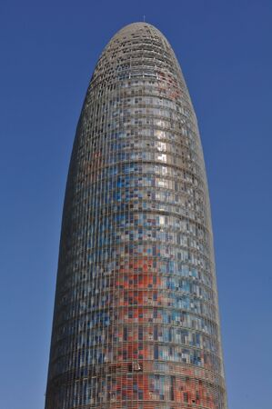 frac12: BARCELONA, SPAIN - JULY 26: Torre Agbar near Pla&iuml,&iquest,&frac12,a de les Gl&iuml,&iquest,&frac12,ries Catalanes on July 26, 2010 in Barcelona, Spain. marks the gateway to the new technological district of Catalonia, Spain