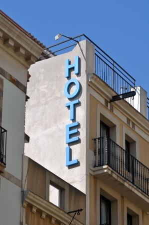 Hotel Sign on Old Building with Blue Sky photo