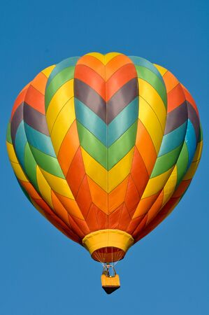 Hot Air Balloon against a blank blue sky photo