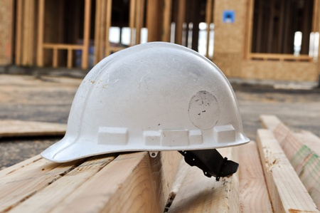 Hard Hat at New Home Construction Site Stock Photo - 8267430