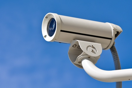 close circuit camera: Security Camera Against Blue Sky Stock Photo