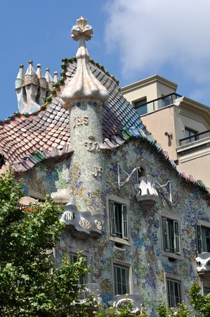 BARCELONA, SPAIN - 25 JULY, 2010: Exterior of Casa Batllo on July 25, 2010, a famous tourist destination restored by catalan architect Antoni Gaudi. Gaudi  decorated the facade with broken ceramic tiles.