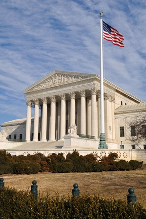US Supreme Court Building with United States Flag photo