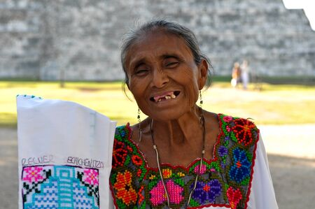 Chichen Itza - February 21: Mayan woman selling souvenirs at Chichen Itza Mayan Temple, Mexico February 21st, 2011. Chichen Itzas was named one of the New Seven Wonders of the World.
