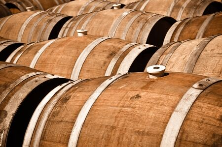 Multiple Wine Barrels in a cellar Stock Photo