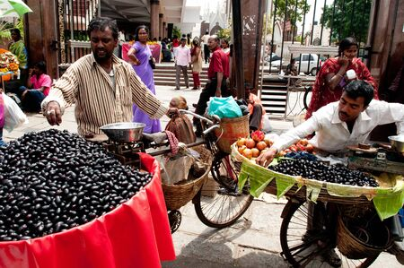 BANGALORE, IN - JUNE 26: Vendors selling fruit on an unnamed street in Bangalore, IN June 26, 2011 in Bangalore, India. 42% of India falls below the international poverty line of $1.25 a day.