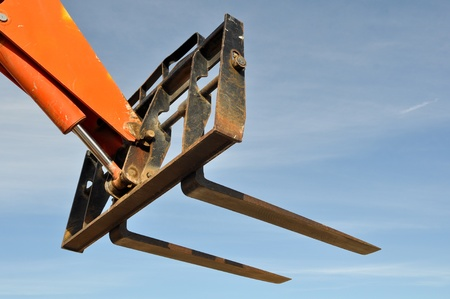 machinery: Forklift Lifter Close Up with Blue Sky