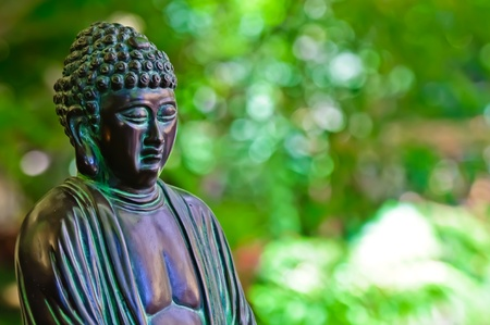budha: Budha Statue with Green Background Stock Photo
