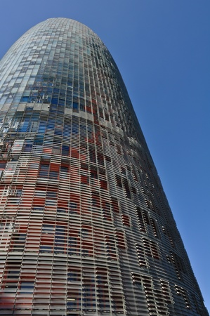 BARCELONA, SPAIN - JULY 26: Torre Agbar, Iconic business tower in Barcelona at July 26, 2010. The tower was officially opened by the King of Spain on September 16, 2005 and at a cost of 130 million euros.