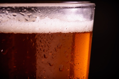 unstrained: Beer on black Background