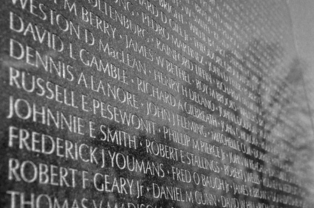 WASHINGTON DC -JANUARY 18: Names on Vietnam War Veterans Memorial on July 18, 2010 in Washington DC, USA.  The memoria receives around 3 million visitors each year.