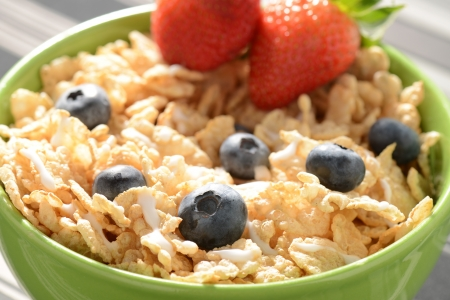 bowl of cereal: Bowl of Cereal with Blueberries and Strawberries