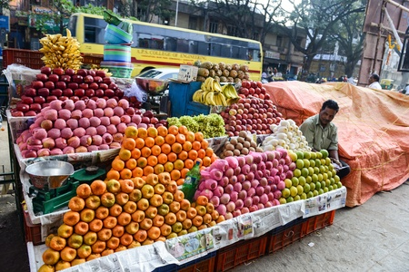BANGALORE, IN - JANUARY 09: Vendor sells fruit on the street in Bangalore, IN January 09, 2013 in Bangalore, India. 42% of India falls below the international poverty line of $1.25 a day.