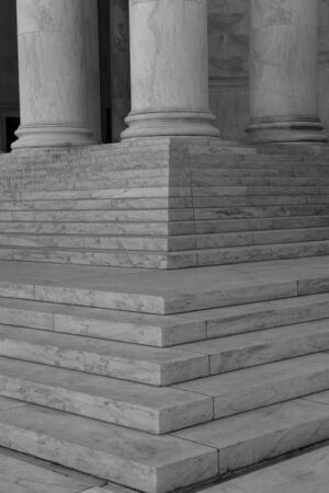 government building: Pillars and Steps in Black and White Stock Photo
