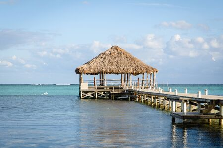 belize: Beach Deck with Palapa floating in the water