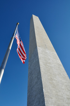 Washington Monument and American Flag photo