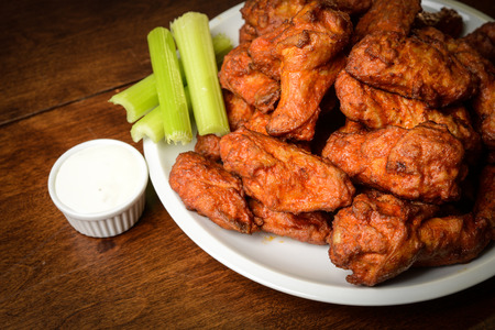 Chicken Buffalo Wings with Celery Sticks and Blue Cheese Dressing photo
