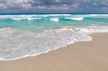beach tropical with white sand and turquoise water under blue sky photo