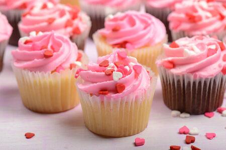 cake decorating: Pink Cupcakes Stock Photo