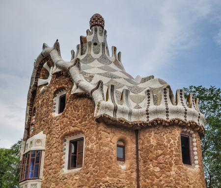 BARCELONA, SPAIN - JUL 22, 2010: Casa del Guarda in Park Guell. It was designed by the Catalan architect Antoni Gaudi and built in the years 1900 to 1914.