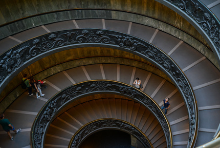 smallest: VATICAN - OCTOBER 18: Unidentified people go down spiral stairs in Vatican Museums on October 18, 2014 in Vatican. Vatican City is the smallest independent state in the world. Editorial