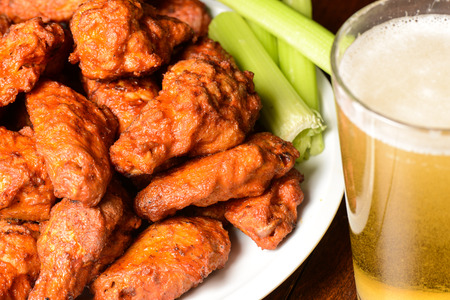 Buffalo Wings with Celery Sticks and Beer 스톡 콘텐츠