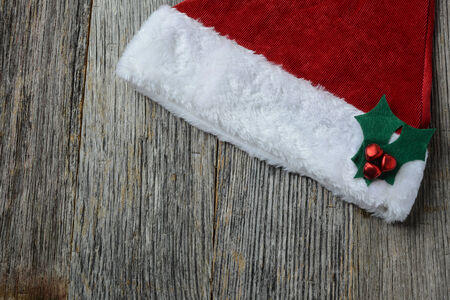 Santa Hat on Rustic Wood Background photo