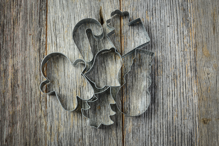 Holiday Cookie Cutters on Rustic Wood Background photo