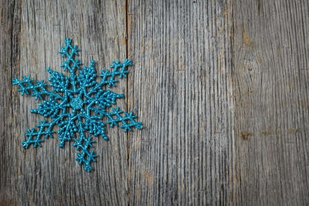 Snowflake Decoration on Wooden Background photo