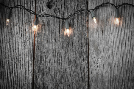 White Christmas Tree Lights with Rustic Wood Background photo