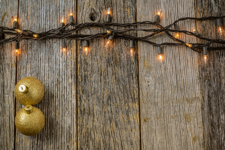 signboard: Christmas Tree Lights with Rustic Wood Background and Gold Ornaments