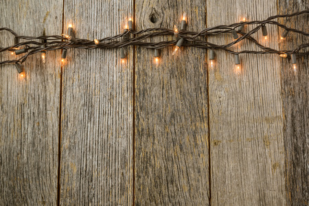 holiday backgrounds: Whiite Christmas Tree Lights with Rustic Wood Background