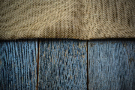 jute: Burlap texture on wooden table background