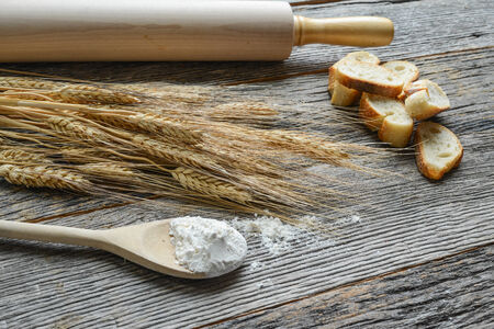 Rolling Pin with Wheat, Flour and Bread photo