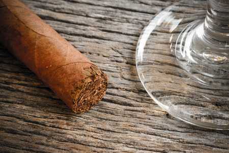 drunks: Cigar with Glass of Brandy or Whiskey on Wooden Background Stock Photo