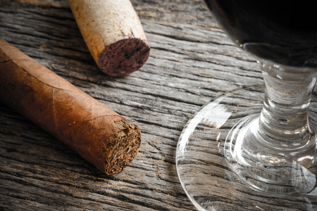 cigars: Cigar with Glass of red wine on Wooden Background