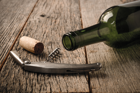 vins: Green Wine Bottle and Cork with Red Wine and corkscrew