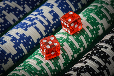 Gambling Chips and Red Dice Stock Photo