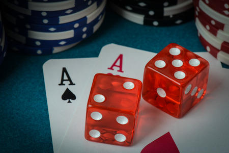 red dice: Playing Cards and Dice used with Gamling Chips Stock Photo