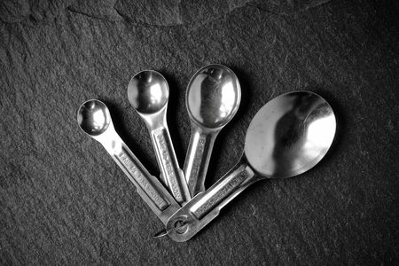 measuring spoons: Measuring Spoons on Slate Stone Background