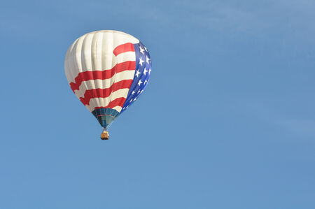 aloft: Red White and Blue Hot Air Balloon Stock Photo