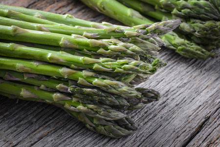 Fresh Asparagus on Rustic Wood Background