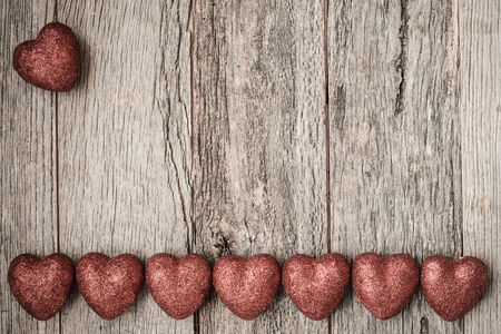 Valentines Day Hearts on Rustic Wooden Background photo