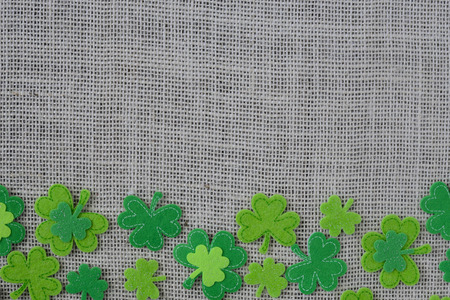 three leafed: Green Clover on Burlap Background