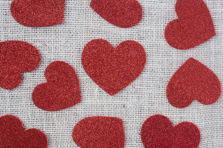 Red Hearts on Burlap Background photo