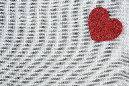 sackcloth: Red Heart on Burlap Background