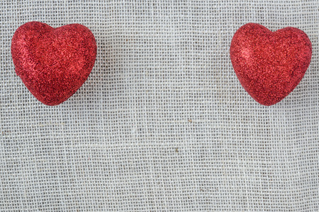 sackcloth: Red Hearts on Burlap Background